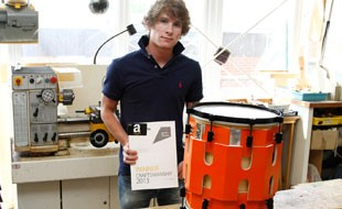 Adam with his award and the winning 'E-Drum'